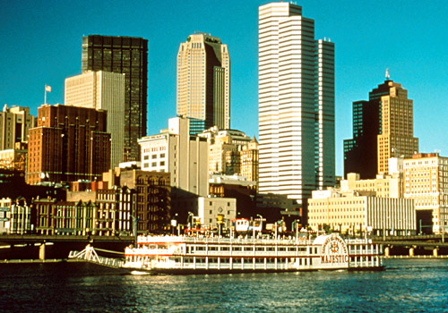 Riverboat Majestic on River with Skyline