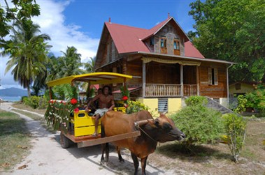 Oxcart and colonial house on La Digue