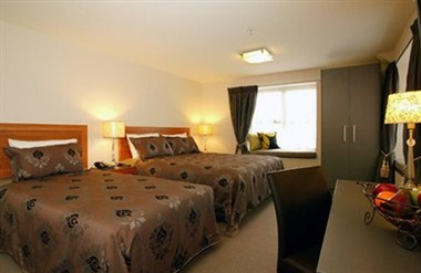Deluxe suite with king and twin beds