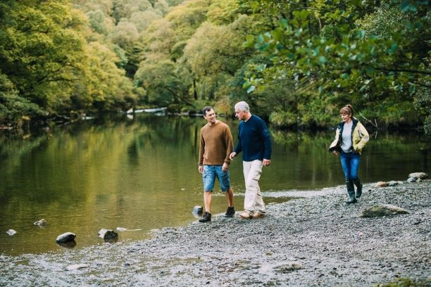 iStock-Family Hiking by Lake-DGLimages