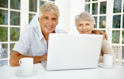 iStock_senior couple laptop kitchen GlobalStock