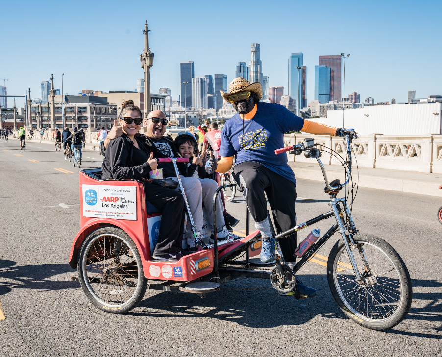 CicLAvia Pedicab and Family with DTLA background