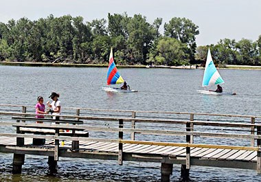 Sailboats and Girls on dock