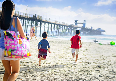 Children running near Oceanside