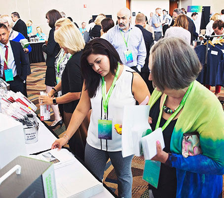 People browsing CliftonStrengths merchandise.