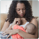 Black Woman Breastfeeding Her Baby