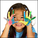 Young Girl With Painted Hands Smiling