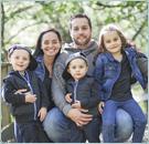 Happy Family Outdoors on Footbridge