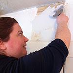 Karen Sautter Errichetti plastering her 1860s home