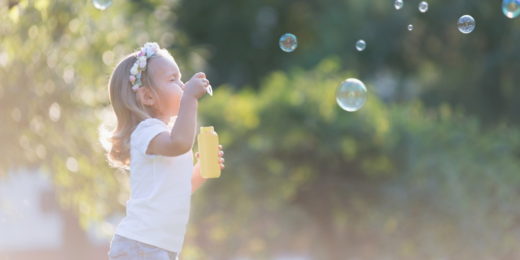 little-girl-playing-with-soap-bubbles-picture-id61