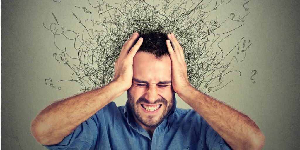 person with many thoughts surrounding their head