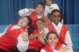 Learning - six students in red vests posing