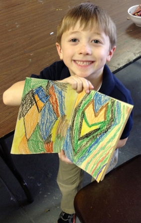 Boy smiling with artwork