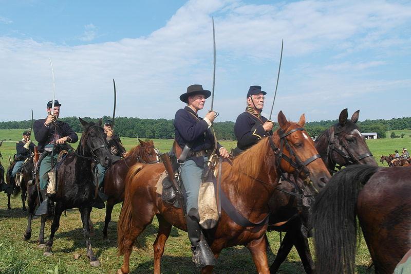 Horsemen advancing with swords drawn