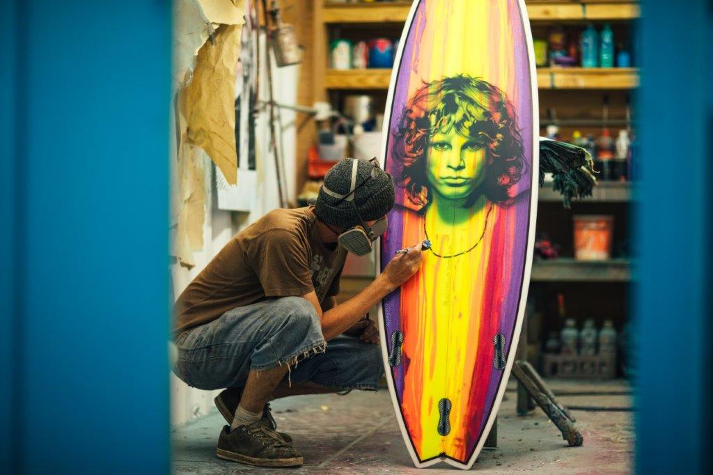 Currumbin Industrial Area man working on surfboard in interior of workshop
