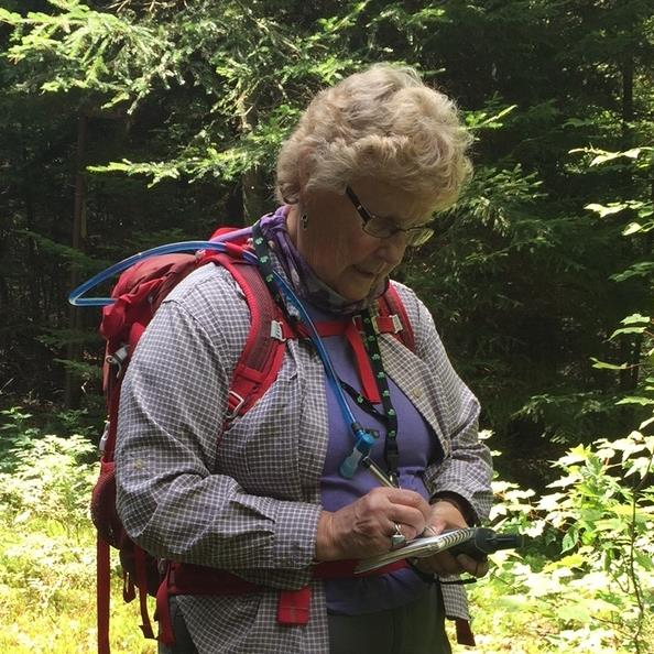 Mary  GPSing notes in the field.JPG