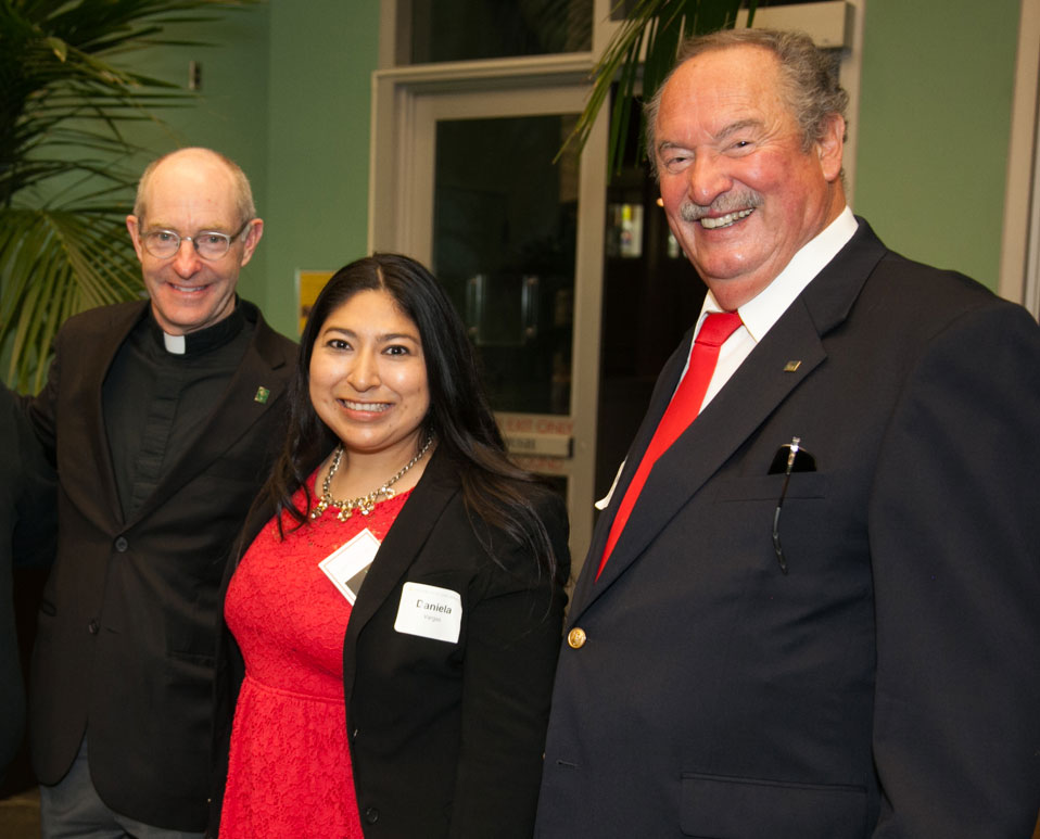 USF President with two alumni