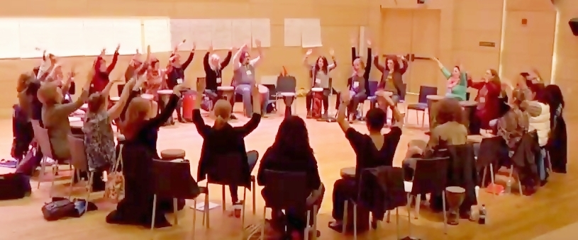 Drum circle, hands in air