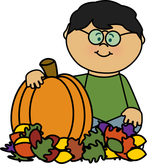 boy-sitting-in-leaves-with-pumpkin