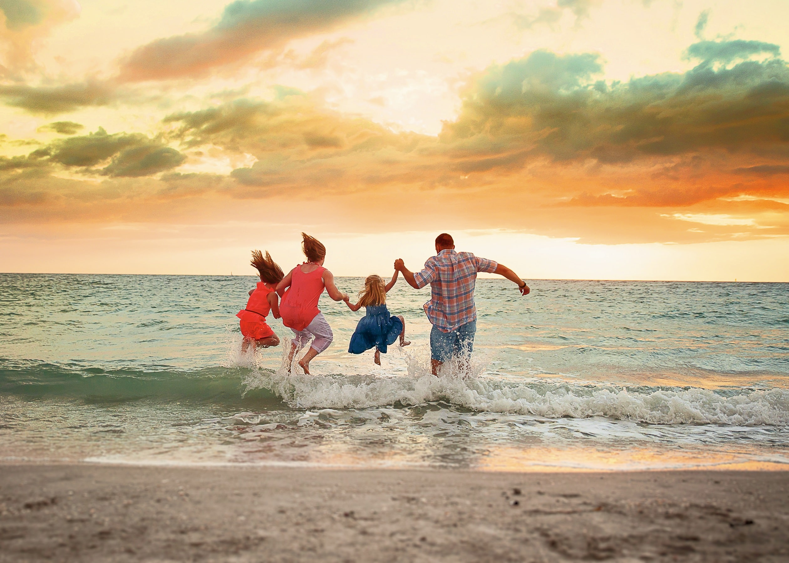 Family Jumping into the Water at Sunset - St. Pete Beach-min