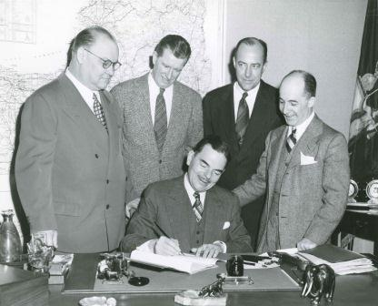 Dewey Signing Legislation